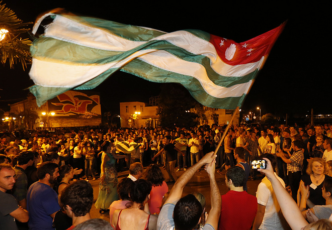 Supporters of Raul Khadzhimba celebrate in the center of Sukhum