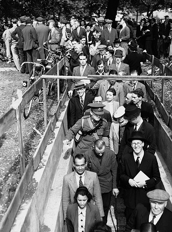 Londoners go into a bomb shelter during the first air-raid warning