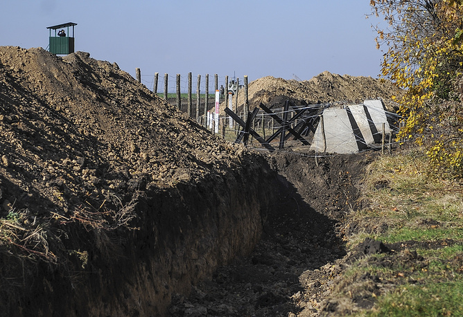 Photo: A trench, part of a project that envisages the construction of a wall along Ukraine's border with Russia, Kharkiv region, Ukraine, 15 October 2014