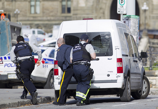 At approximately 9:50 a.m. a suspect clad in black and reportedly carrying a double-barrel shotgun fired at a guard of honor at the World War One War Memorial in downtown Ottawa and then, according to eyewitnesses, ran in the direction of the country's parliament