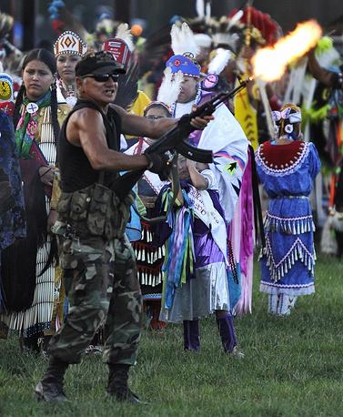 Photo: A member of the Black Hills Veterans Group with Kalashnikov assault rifle at the Lakota Pine Ridge Reservation in South Dakota, USA