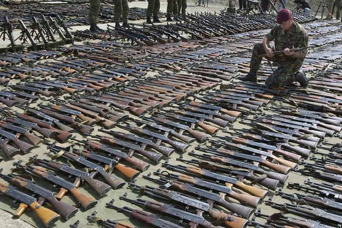 Photo: Kalashnikov AK47 gun among weapons on display that are collected from the ethnic Albanian rebels as part of Operation Essential Harvest in southern Macedonia, 2001