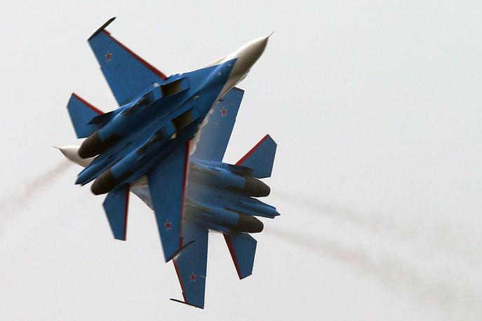 Photo: The Russkiye Vityazi (Russian Knights) aerobatic team performs a demonstration flight at Airshow China 2014