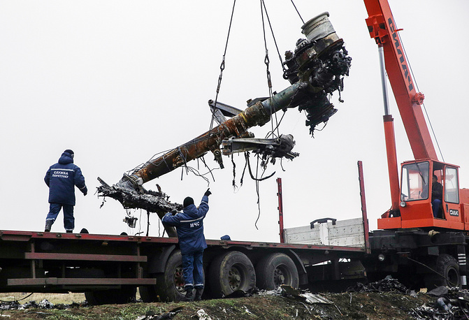 Fragments of the Malaysia Airlines passenger flight MH17 which crashed near the village of Grabovo are being loaded onto trucks to be sent to the Netherlands for investigation