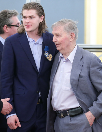 Viktor Tikhonov and his grandson Viktor, who won a gold medal in the 2014 IIHF World Championship with Russia and led the tournament in scoring