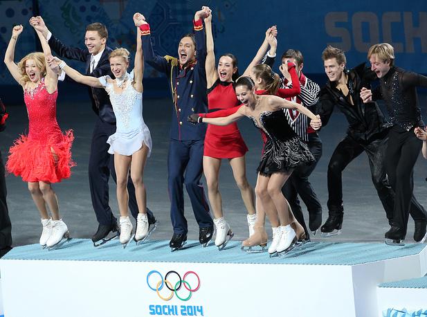 Russian figure skaters Yekaterina Bobrova, Dmitry Solovyov, Tatiana Volosozhar, Maxim Trankov, Ksenia Stolbova, Fedor Klimov, Yulia Lipnitskaya, Yelena Iliynykh, Nikita Katsalapov and Yevgeny Plyuschenko celebrate team gold at the Sochi Olympics