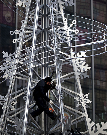 Installation of Christmas tree outside a shopping mall in Beijing, China