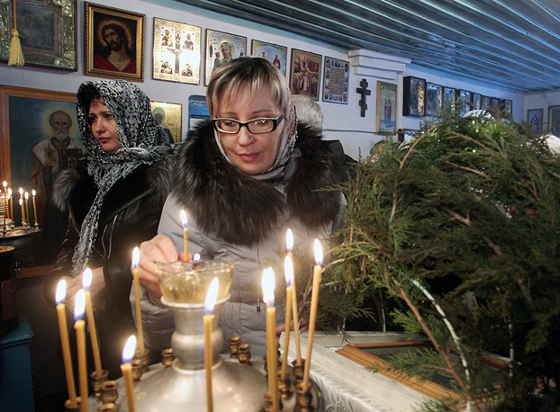 Christmas celebration after the service in the Orthodox church in the village of Sosnovka, 80 km from Bishkek, Kyrgyzstan
