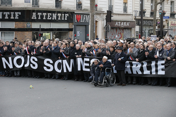 Photo: French officials, with Paris mosque rector Dalil Boubakeur in a wheelchair, during march in Paris