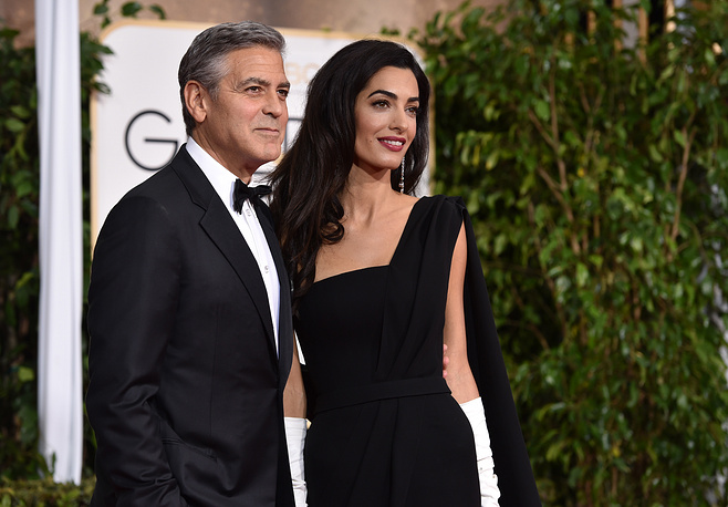 George Clooney received the Cecil B. DeMille Award for achievement at the Golden Globes night. Photo: George Clooney and Amal Clooney
