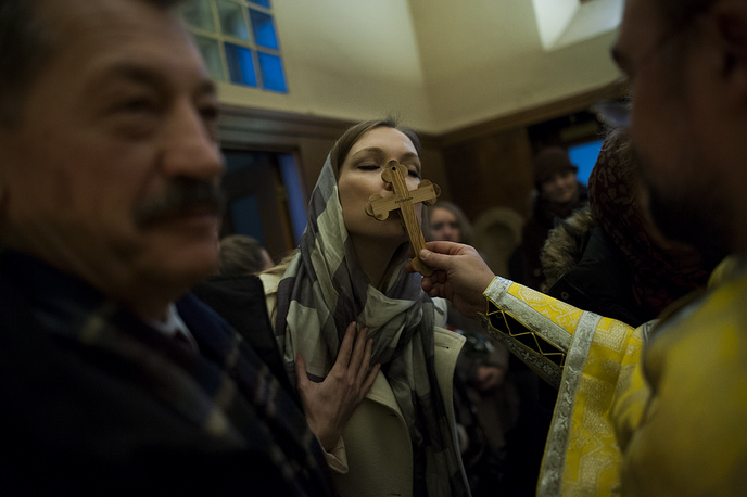 Religious ceremony of the Baptism of Jesus Christ, in Pamplona, northern Spain  purify their health with blessed water.