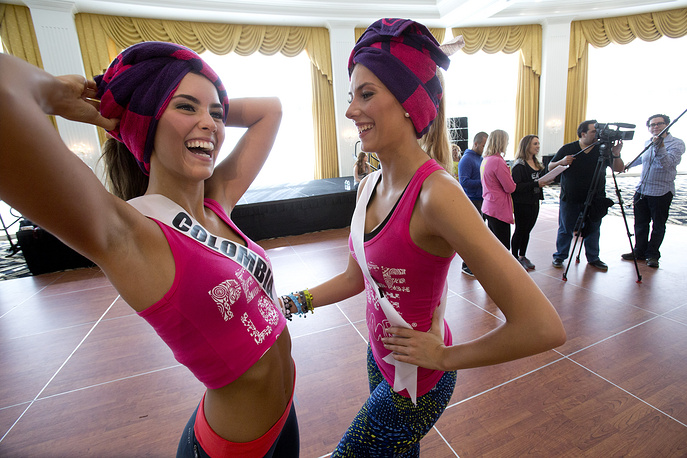 Miss Universe contestants Paulina Vega of Colombia and Camille Cerf of France after a Zumba Class for the contestants