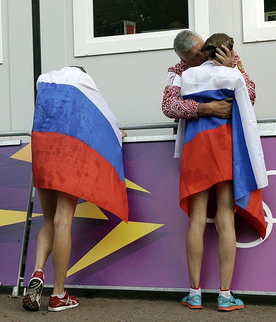 The International Association of Athletics Federations (IAAF) should decide whether to rescind Olympic medals from a group of Russian athletesю Photo: Gold medalist Elena Lashmanova of Russia and teammate and silver medalist Olga Kaniskina after the women's 20-kilometer race walk competition at the 2012 Summer Olympics, London