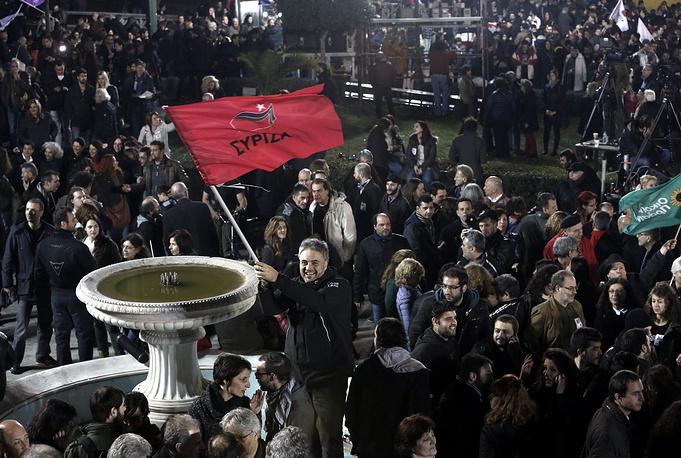 Thousands of Syriza supporters flocked to the Athens University building, chanting and waving the party's red and white flags as party leader Alexis Tsipras addressed the crowd. 'The vote of the Greek people has closed the vicious circle of austerity,' he said, declaring Greece's 240-million-euro bailout now 'a matter of the past'