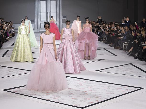 Models walk the runway during Giambattista Valli's fashion show at Paris Fashion Week 2015