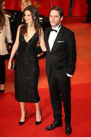 German actor Daniel Bruehl and Felicitas Rombold in Berlinale Palace