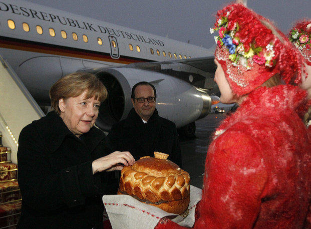 Angela Merkel and Francois Hollande (background)
