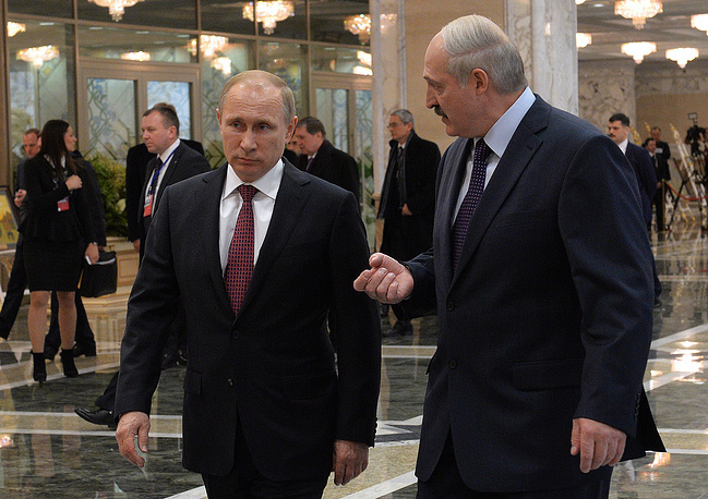 Russia's president Vladimir Putin and Belarus' president Alexander Lukashenko at a meeting, at the Palace of Independence in Minsk