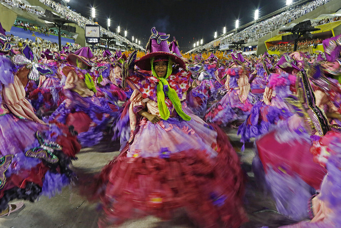 Dancers from the Mangueira samba school during the Carnival parade at the Sambadrome in Rio de Janeiro