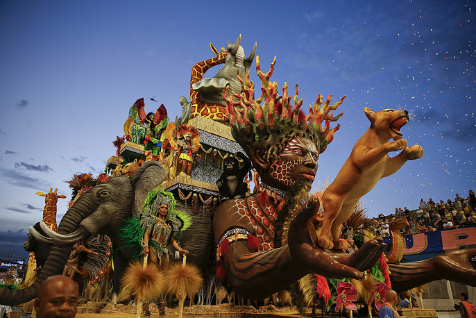 Dancers from the Nene de Vila Matilde samba school perform on a float during a carnival parade in Sao Paulo