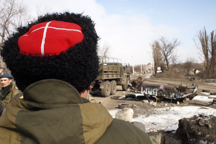 """Donetsk region' self-defense militia command previously reported that a Ukrainian force grouping numbering 8,000 men opposed them in the Debaltsevo area when the encirclement manoeuvre was launched. Photo: Cossack commander Nikolai Kozitsyn, known to his fellow militia fighters by the nom de guerre """"Daddy"""""""