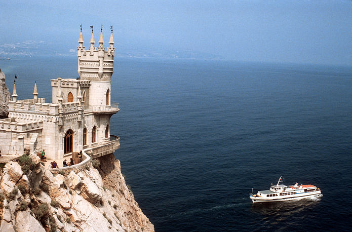 The first anniversary of Crimea's reunification with Russia is marked on March 16. Photo: A view of the Swallow's Nest Castle, built on top of Aurora Cliff at the Ai–Todor Cape, Crimea