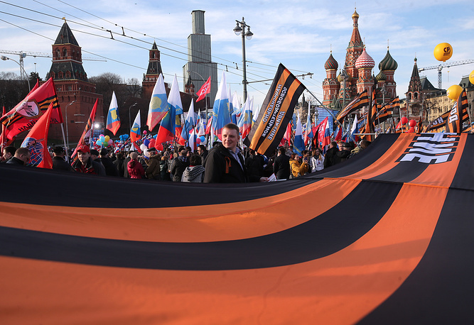 Participants of Moscow's rally marking the first anniversary of Crimea's reunification with Russia