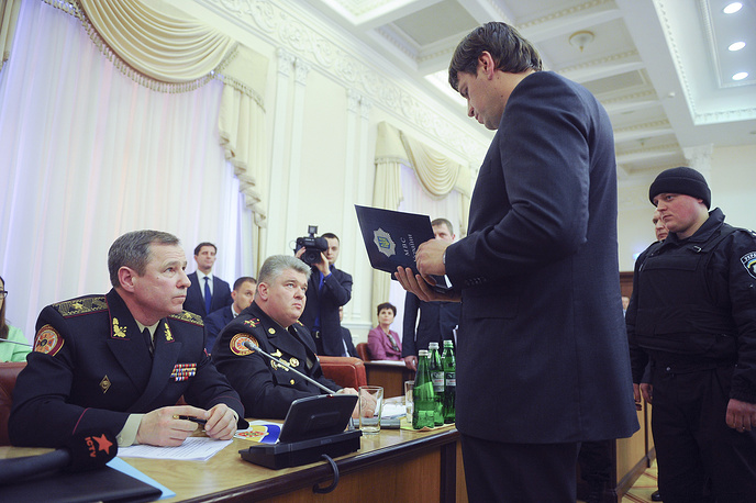 A prosecutor reads an accusation to the chief of Ukraine's state service for emergency situations