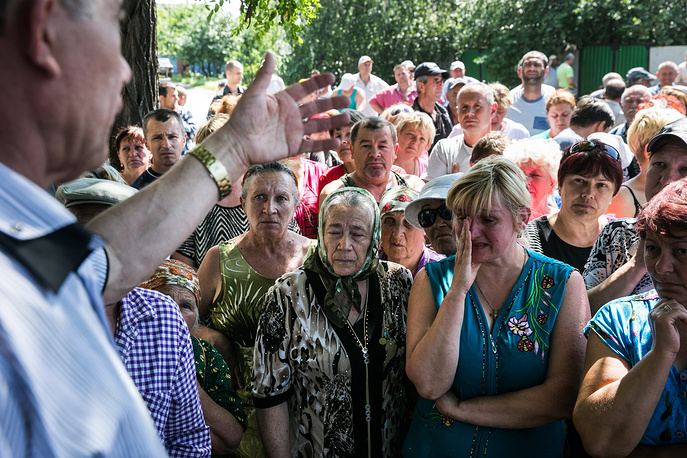 Local residents of Semyonovka village in Donetsk region, whose homes were affected by heavy artillery shelling by the Ukrainian forces, May 2014