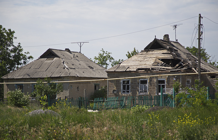 Over 3,400 houses have been damaged in the city of Donetsk over the period of fighting in Donbas, according to the head of the Donetsk city administration. Photo: Damaged houses after shelling in the town of Maryinka, near Donetsk