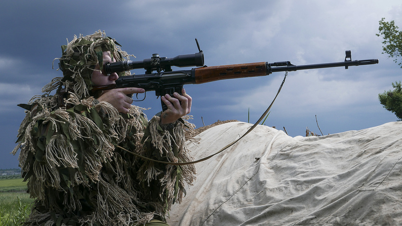 A militiaman looking toward Ukrainian positions near the division line with the Ukrainian army near Dokuchayevsk, eastern Ukraine