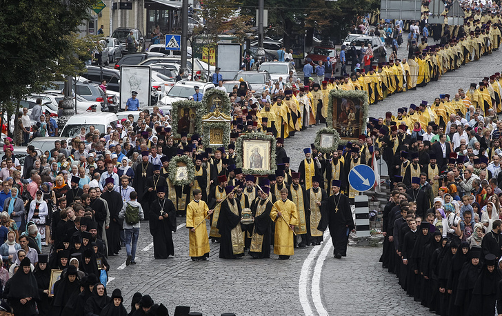 Priests from the Ukrainian Orthodox Church of Moscow Patriarchate marching at St. Vladimirs Hill in Kiev