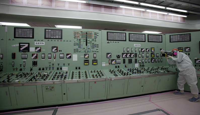Japan's energy companies submitted applications for another 19 reactors to resume their operations, but the process was slowed down by safety checks and paperwork. Photo: Central operating control room of the No. 1 and No. 2 reactors of Tokyo Electric Power Co. at the Fukushima Dai-ichi nuclear power plant in Okuma, 2014