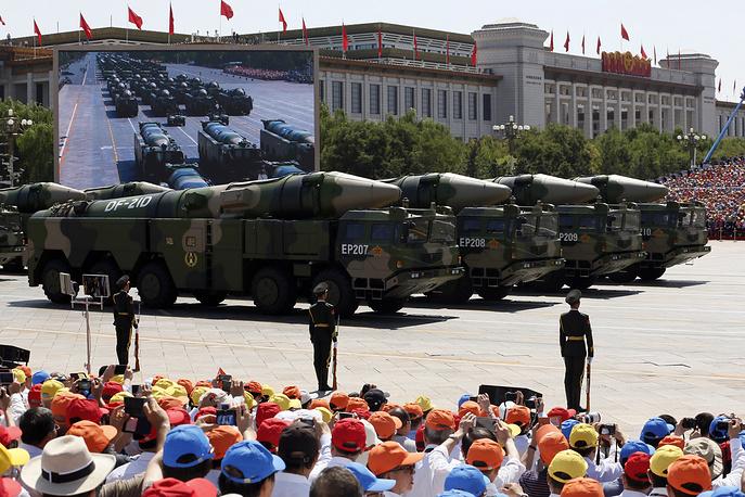 Military vehicles carring DF-21D anti-ship ballistic missiles