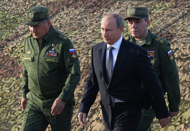 Russia's Defense Minister Sergei Shoigu, President Vladimir Putin and chief of the General Staff of the Russian Armed Forces Valery Gerasimov at the Donguzsky firing range