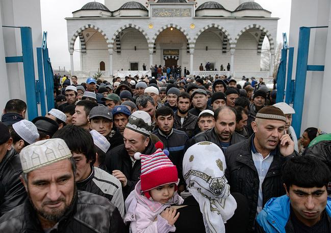 Muslims seen outside the Imam Ismail Al-Bukhari's Copper Mosque during the celebration of Eid al-Adha, in the town of Verkhnyaya Pyshma, Sverdlovsk region