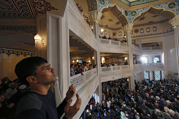 Russian Muslims attending morning prayers to celebrate Eid al-Adha at the Moscow Cathedral Mosque