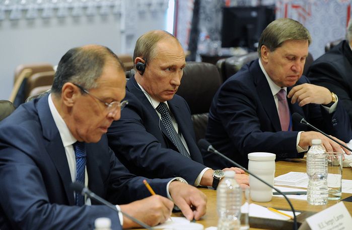 Russia's Foreign Minister Sergei Lavrov, Russia's President Vladimir Putin and Presidential Aide Yuri Ushakov during talks with US President Barack Obama after the 70th session of the UN General Assembly