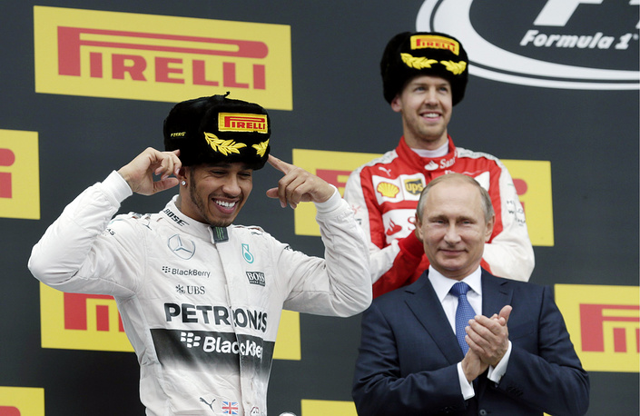 Race winner Lewis Hamilton, Russia's president Vladimir Putin and first runner-up Sebastian Vettel during the podium ceremony for the 2015 Formula 1 Russian Grand Prix