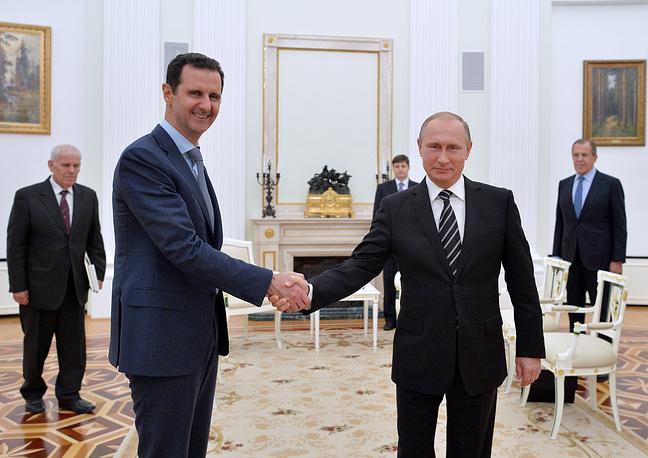 Russian President Vladimir Putin shaking hand with Syrian President Bashar Assad in Moscow's Kremlin