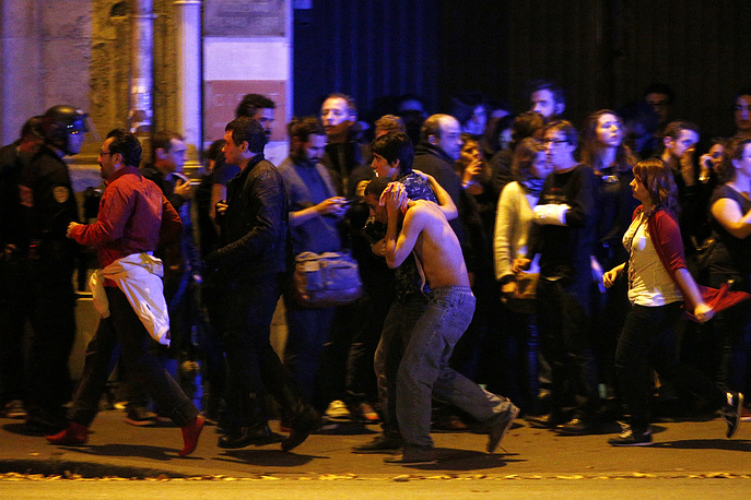 Wounded people being evacuated outside the scene of a hostage situation at the Bataclan theater