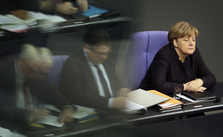 Angela Merkel listening to a meeting of the German Federal Parliament in Berlin, Germany, November 25, 2015