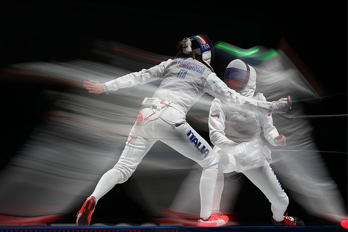 Italy's Elisa Di Francisca and Russia's Inna Deriglazova fight in the women's team foil match at the 2015 FIE World Fencing Championships, July 19, 2015