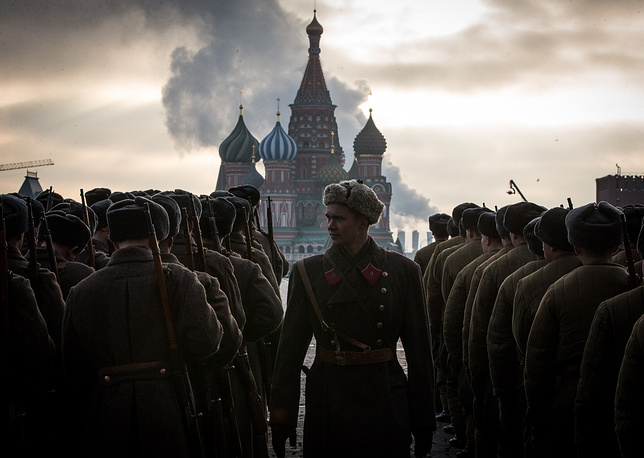 Participants dressed as Red Army soldiers marching through Moscow's Red Square during a military parade. The event commemorated the 74th anniversary of the historical 1941 Red Square Parade when Red Army troops were leaving for the front lines of World War II, November 7, 2015
