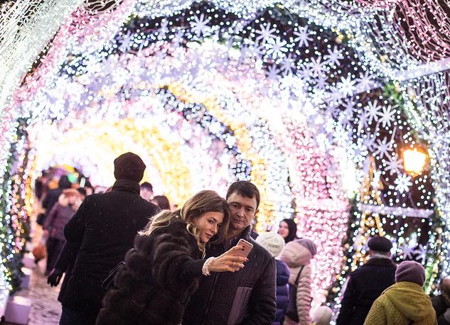People walking through the light tunnel in Tverskoy Boulevard