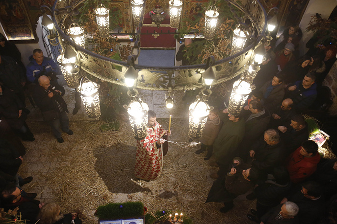 Orthodox priests leading an Orthodox Christmas service at the Bosnian Orthodox church in Sarajevo, Bosnia