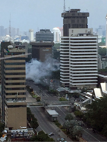 Smoke billows from an explosion in Jakarta