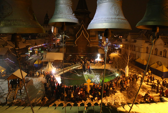 Orthodox believers plunging into a basin with cold water during celebrations of Orthodox Epiphany at the Izmailovo Kremlin in Moscow
