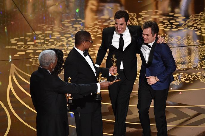 Screenwriter Josh Singer and actor Mark Ruffalo of Best Picture winner 'Spotlight' celebrating onstage with Morgan Freeman