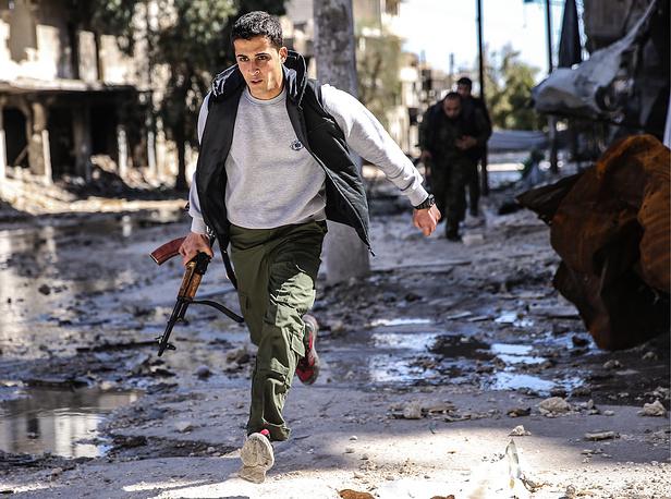 Kurdish militia members in Aleppo's Sheikh Maqsoud neighbourhood